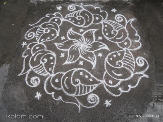 Rangoli 9 to 5 interlaced dots: Friday sangu kolam in white. by revathiilango