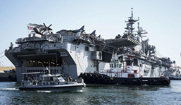 JEBEL ALI, United Arab Emirates (June 13, 2017) The amphibious assault ship USS Bataan (LHD 5) prepares to depart Jebel Ali, United Arab Emirates. The ship and its amphibious ready group are deployed to the U.S. 5th Fleet area of operations in support of maritime security operations to reassure allies and partners, and preserve the freedom of navigation and the free flow of commerce in the region. (U.S. Navy photo by Mass Communication Specialist 2nd Class Sean Furey/Released)