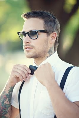 Another tatted guy in dress clothes.