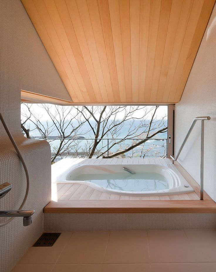 i could get used to having a bathroom like this!  i'd never want to leave this tub with a view like that!