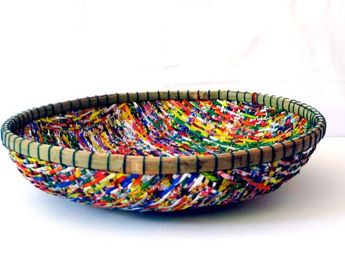 This colorful basket has been handcrafted in Hue, Vietnam by young disabled artisans at the Spiral Foundation Workshop in Hue. Strips of bamboo covered with recycled plastic wrappers are woven together following the style of the Vietnamese baskets traditionally used in their everyday lives. Sturdy, washable, colorful and long-lasting, these baskets can hold anything from coins to keys, and fruit to chips. All net proceeds from the sale of this item funds medical programs at OGCDC (Office of…