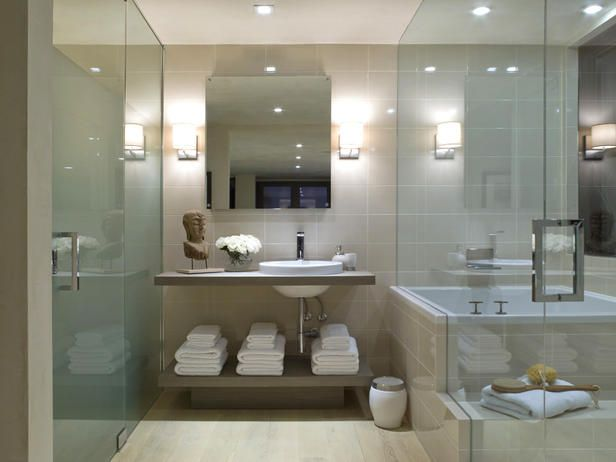 Designer's Notes  Behind the glass doors, a Japanese tub and shower make up the wet room. Frosted glass doors parallel the room on the other side to conceal a water closet or toilet room.