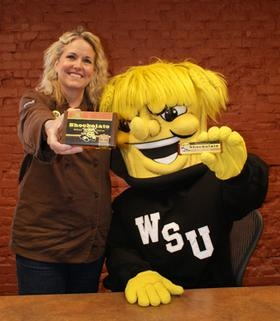 Local Celebrity, WU Shock with owner, Beth Tully showcasing part of the Shockolate collection.    Wichita State connects students to real-world, experience-based learning opportunities only found in Kansas' largest city – putting them ahead of the competition and helping them build the futures they want.