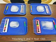 teacher invited the preschoolers to paint on ice blocks with watercolors