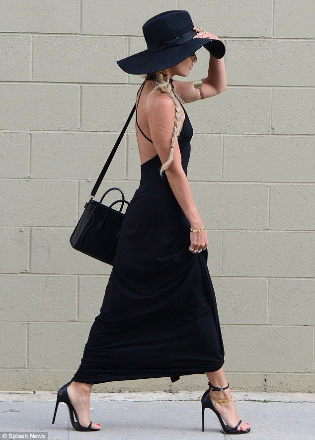 Vanessa Hudgens stepped out in a slinky backless black gown with a derby hat for a lunch date in Studio City