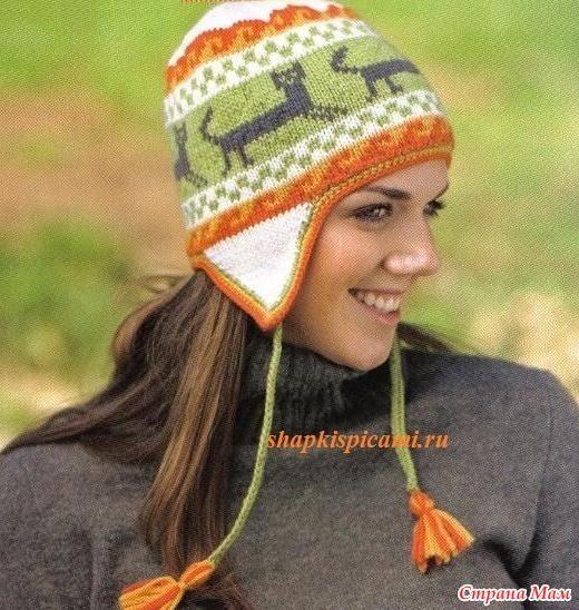 Всем любителям кошачьих обязательно понравится эта женская шапочка с веселым и ярким узором. Ушки с завязками делают эту модель еще и очень практичной.  Размеры (по окружности): 51 см (56 см).
