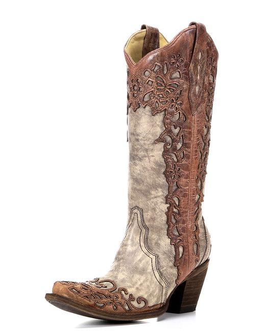 <div>Rock your feminine side with these luxurious Corral Sand/Cognac Laser Overlay Boots. Show your style with a distressed sand leather foot and shaft accented with cognac-colored laser overlay. </div><div><br></div><div>This boot features handcrafted construction of the upper, lining, heel, and sole for a distinctively unique detailed finish. </div><div><br></div><div>Stepping into this boot, you will feel the quality of the supple leather lining and comfort of the performance ...