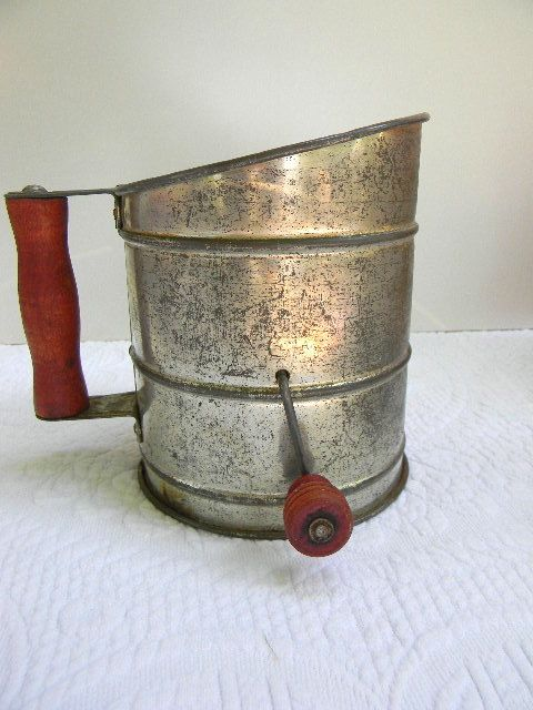 vintage flour sifter, with wooden handle and knob. cute.