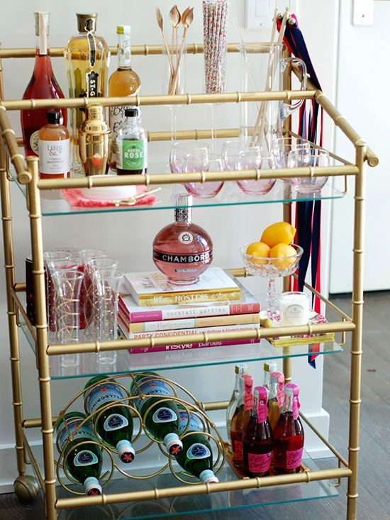 We love Monica's well-stocked home bar. A brass bar cart is a must-have for adding a touch of Old Hollywood glamor to your home.