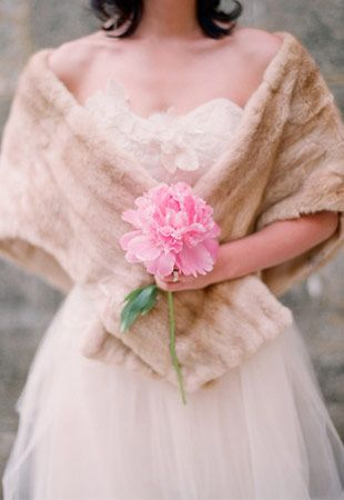 Bride in Fur - Read more on One Fab Day: http://onefabday.com/bride-and-bridesmaids-cover-up-ideas/