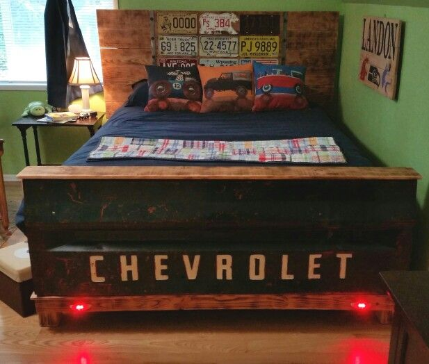 Chevy tailgate bed with license plate headboard.