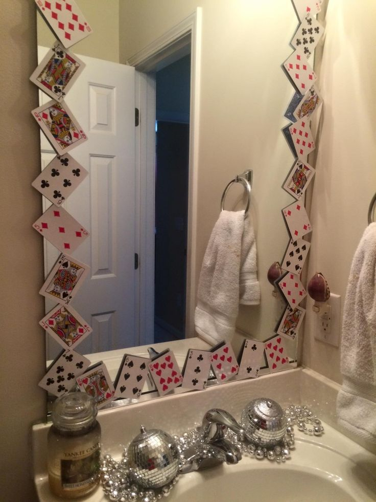 Vegas themed birthday party! Deck out the bathroom with a playing card border and some bling along the sink. #vegasparty #diyplayingcards