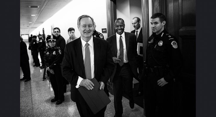Sen. Mike Crapo (R-Idaho) escort Carson from his nomination hearing Thursday. M. Scott Mahaskey/POLITICO