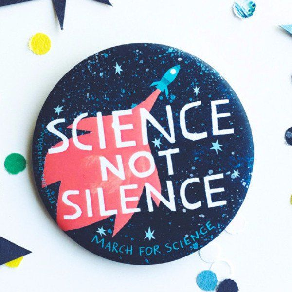 Penelope Dullaghan designed and photographed the March for Science Pin featuring the Science Not Science message