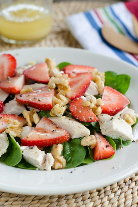 Chicken salad with spinach, strawberries, and a simple walnut oil and champagne vinegar dressing. Paleo, gluten-free, dairy-free and ready in 5 minutes.
