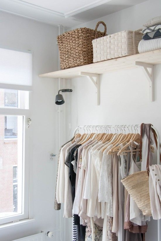 simplistic organized look - appealing to the eye - adds to the aesthetic. not completely ideal, because the clothes and belongings are visible, and my client is a private person, so this would not fit her vision, but the shelving to organize this smaller space is functional.  image by: Avenuelifestyle