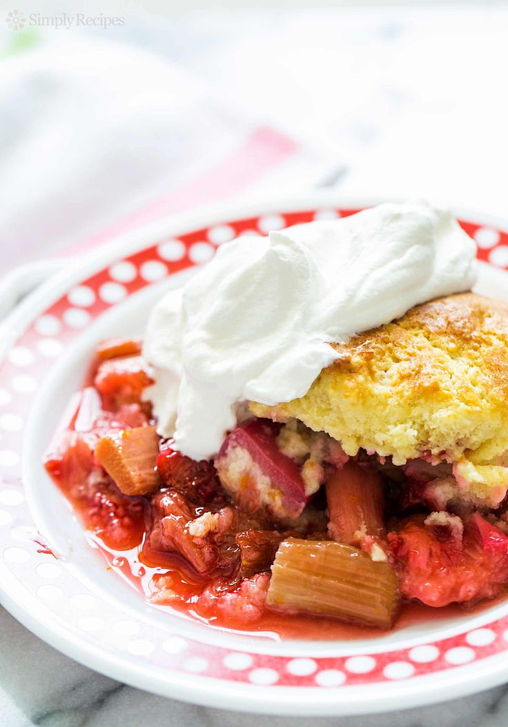 Easy-to-make strawberry rhubarb cobbler!  Strawberries, rhubarb, sugar, orange peel baked with a biscuit-like cobbler crust topping. Serve with whipped cream. On SimplyRecipes.com