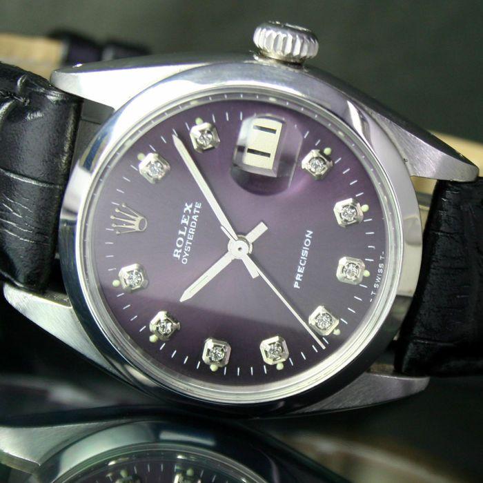 1962s Rolex Oyster datum precisie stalen horloge Ref 6694  BESCHRIJVING:Code 123341) wijzerplaat: The Original Dial heeft zijn vernieuwd door een deskundige te maken het eruit ziet als nieuwe & onberispelijk.Mooie Shinning paars kleur wijzerplaat met aangepaste gemaakt staal Index & Radium Dot Index staal & Radium handen.2) case: Stainless Steel Case heeft zijn gepolijst.Geval terug Refnr. 6694Case diameter 34 mm zonder kroonAanbouwmateriaal tip naar tip 415 mm3) machine: Hand kronkelende…