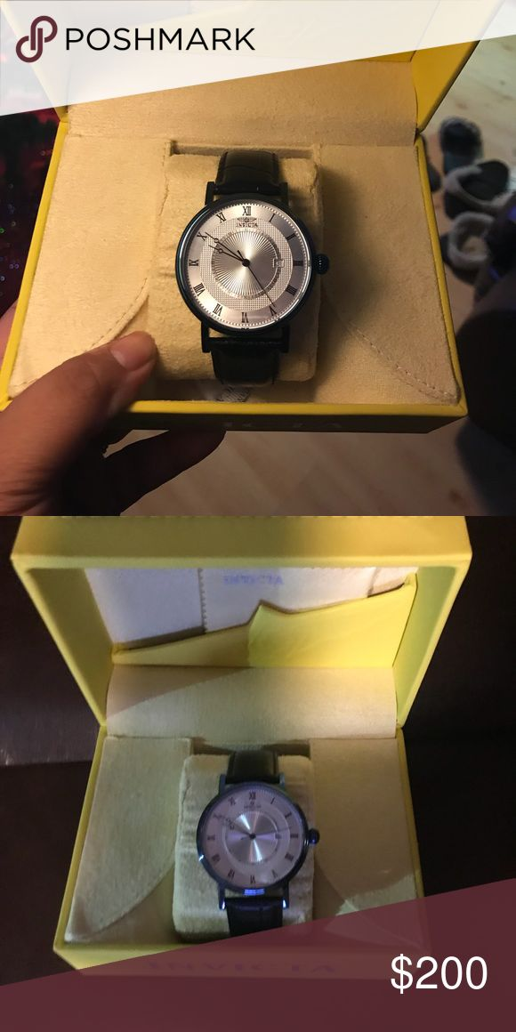 Invicta watch Brand new never worn invicta watch. Blue rim with white face and black band Invicta Accessories Watches