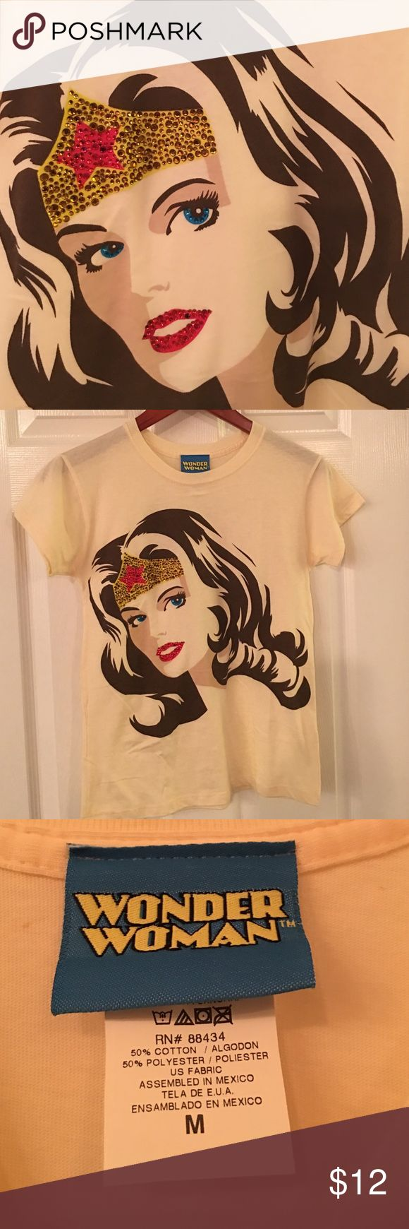 ⚡️Wonder Women Tee⚡️ NWOT Cream colored T-shirt. Wonder woman detailed with rhinestones. Fabric content is 50% cotton and 50% polyester. Absolutely beautiful grown-up DC comics T-shirt! DC Comics Tops Tees - Short Sleeve