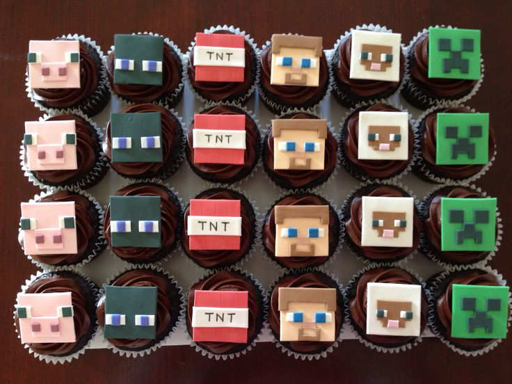 Minecraft cupcakes with Steve, creeper, enderman, TNT, sheep and pig.