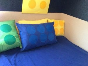 Maybe use the iron-on vinyl idea in this blog that was used for the pillows to make fabric storage boxes for Legos