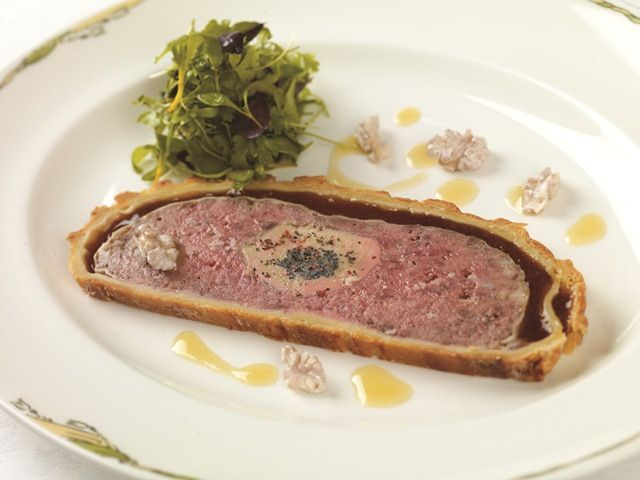 Seasonal game pâté wrapped in pastry with truffles and foie gras