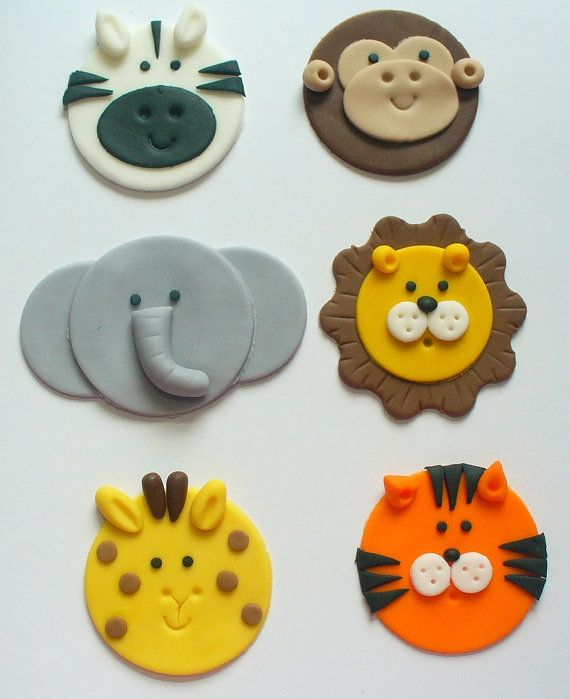 One dozen -12-toppers, 2 of each as shown. Giraffe, lion, monkey, elephant, tiger and zebra. Approximately 2 to 2 1/4 inches across,