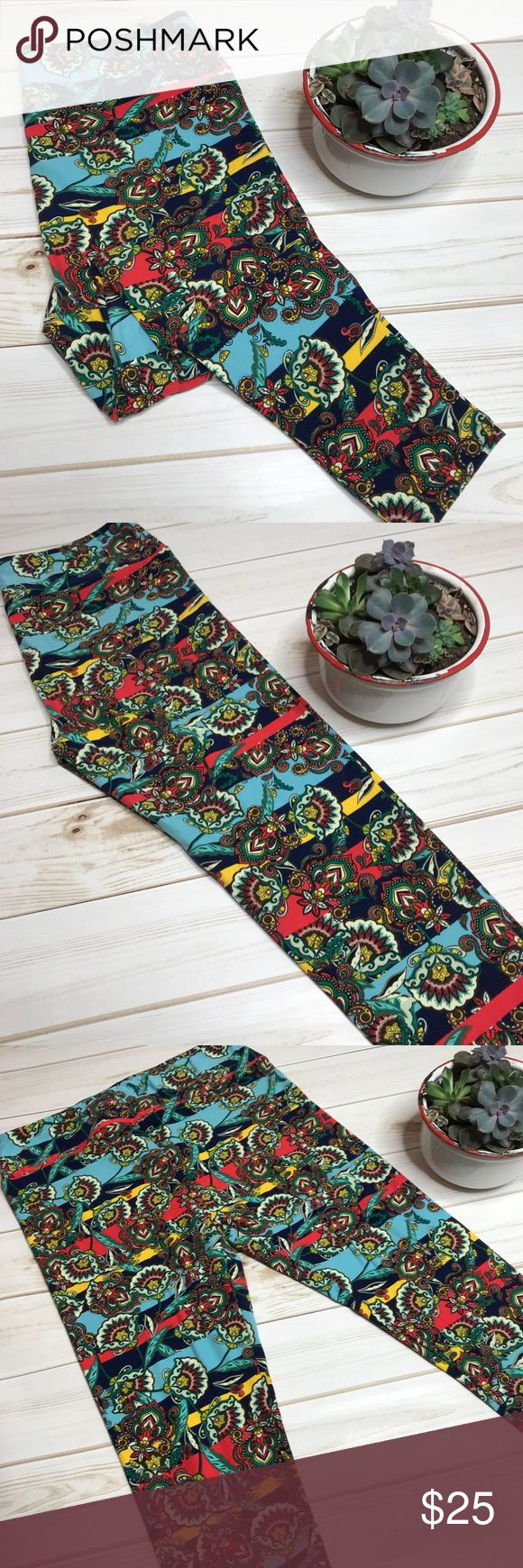 NWT LuLaRoe TC Leggings These stunning leggings have a gorgeous floral print with a stripe. Red, blue yellow, green and cream take center focus on these beauties. Known for their buttery soft feel, LuLaRoe has made leggings not just tights, but pants too! Comfort meets fashion! These tall and curves leggings will fit size 12-18. LuLaRoe Pants Leggings