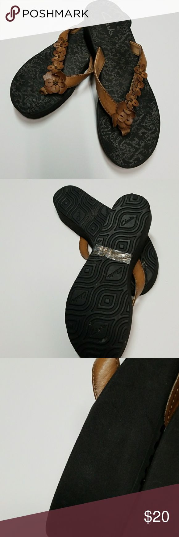 "Clarks Flip Flops Brown Size 9 Beach Pool Shoes Clarks Flip Flops Brown  Size 9  Beach Pool Knock around Shoes Well made lined Straps Excellent Condition Heel Approx  1.5 "" back and 1"" front Shoes"