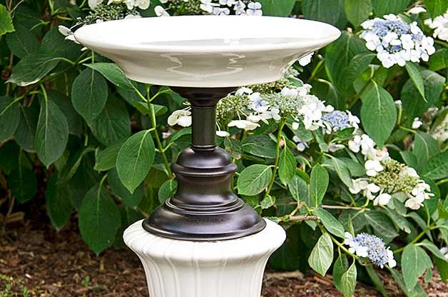 Recycled garden ideas use old lamp bases as pedestals for for Garden ideas using recycled materials