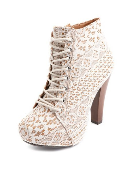 So wish they had my size - a really cute boot to take you to Spring. Vintage Lace Lace-up (really a zipper on the side) bootie (also in tan and orange) Charlotte Russe.