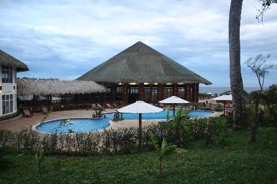 The sleek and smooth finish of Hotel Media Luna's synthetic thatch roof
