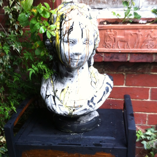Painted Concrete bust on piano bench