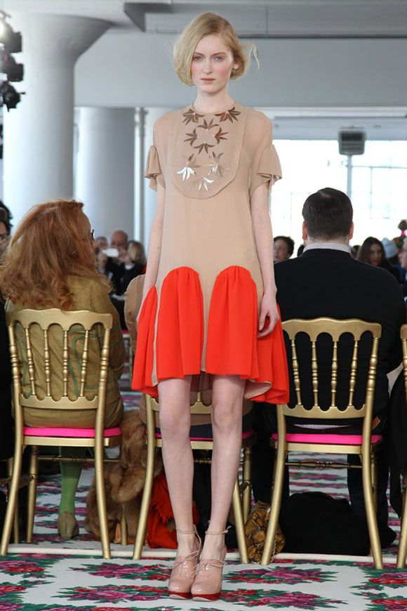 Brilliant orange inserts in Delpozo dress with beige upper body and gold embellishments. RTW fall 2013