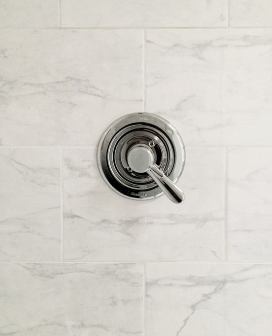 tile is Daltile Marissa Cararra, available at Home Depot for $2.21 a square foot.