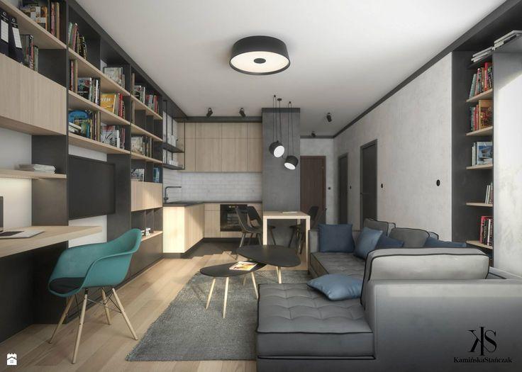 Mieszkanie dla młodego małżeństwa o powierzchni 54 mkw. Głównym założeniem projektowym było pogodzenie strefy pracy z możliwością przechowywania dużej ilości książek przy małej ilo ...