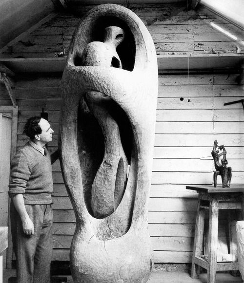 Henry Moore with Upright Internal/External Figure, 1953–4, in his studio at Hoglands, Perry Green