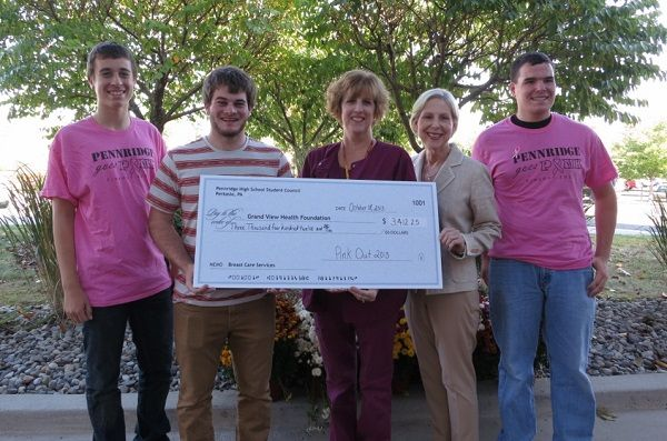 "Pennridge High School students present the proceeds from the school's annual ""Pink Out"" to Grand View Hospital. Pictured are, from left, Noah Lare, student council member; Joe Firuta, student council member and event coordinator; Kim Oates, mammography coordinator at Grand View Hospital; Kathy Burkey, chief nursing officer and vice president of patient services; and Evan Kerr, student council member. Pennridge High School students raised $3,412.25. Photo courtesy of Grand View Hospital"
