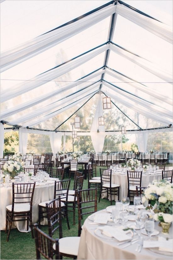 A wedding reception tent that still allows the daylight to brighten your party with family style seating. #weddingreception #tabledecor #weddingchicks Venue: Annandale Golf Club ---> http://www.weddingchicks.com/2014/04/24/timeless-california-wedding/