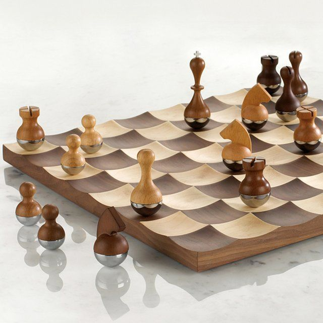 The Wobble Chess Set By Umbra Is A Stunning Wooden Chess Board And Chess  Pieces Set That Adds Movement To The Popular Game With Its Unique Design.