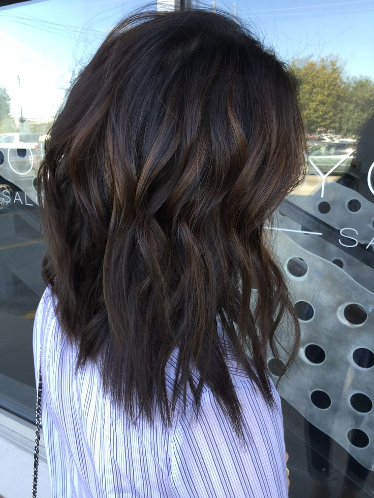 Soft deep caramel balayage on dark brown hair. Dimensional brown hair