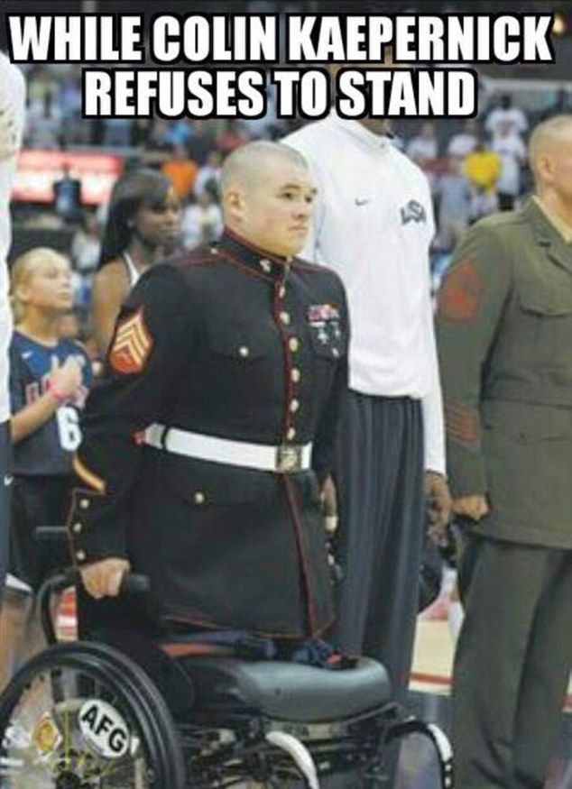 Others tweeted this powerful image of a wounded veteran holding himself upright in his wheelchair for the anthem despite having no legs