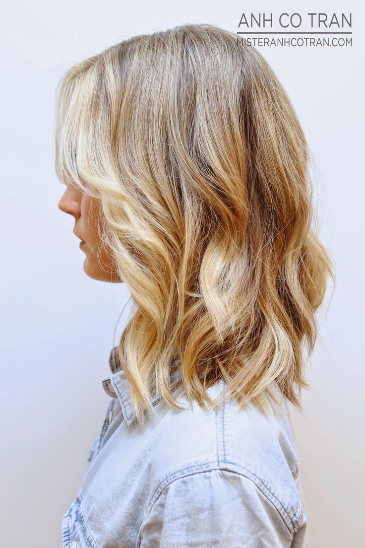 """A natural looking beige blonde base with bright buttery blonde highlights and a piecey long bob with minimal long layers that help create that """"lived in"""" look"""