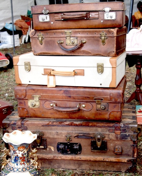 Flea market finds.  Stacked Suit cases at Larry's Old Fashion Trade Days in Winnie, Texas.  A Monthly 2nd  Monday weekend show on I -10 east of Houston.