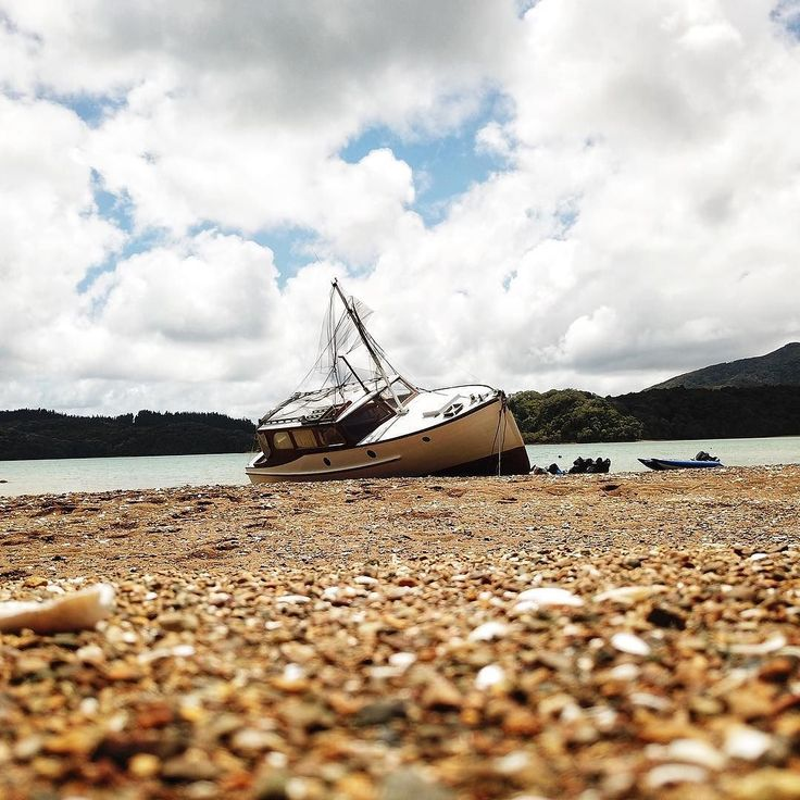 A shipwreck?  No! Its our classic launch Lady Ngaio (she was built in 1928!). This weekend we pulled her up on the beach and pulled 600kg of mussels and oysters off her hull  and were giving her a fresh coat of paint. Shell be all ready for summer soon!  - @theglobalcouple on Instagram