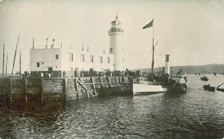 Scarborough harbour, lighthouse and paddle steamer