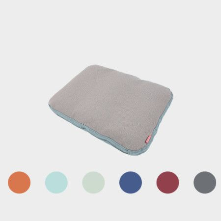 Rounded Pillow from PYTT Living available in six different colors.