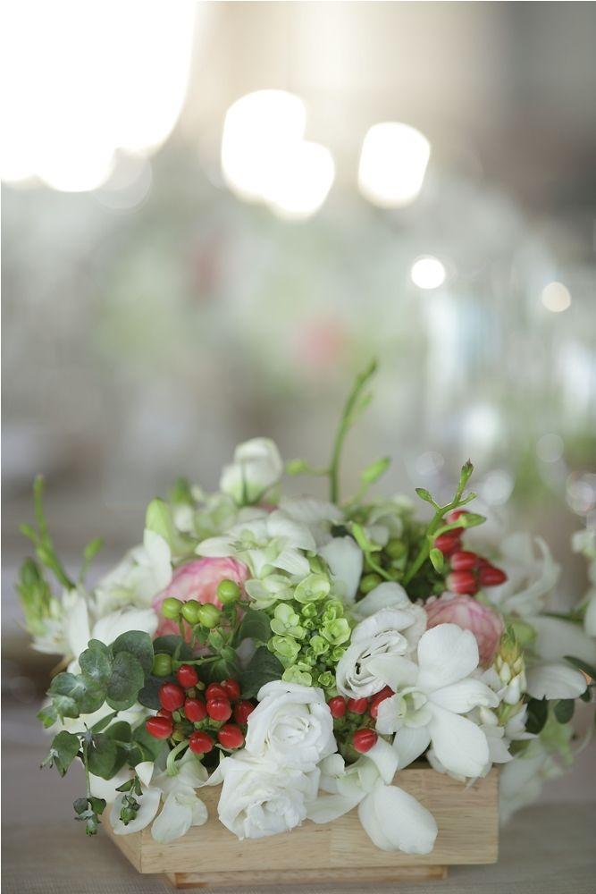 Flower centerpiece in wooden box by Tirtha Bridal Uluwatu Bali