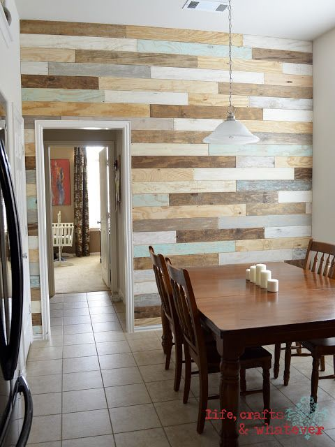 "This ""reclaimed plank"" wall is actually made from plywood pieces. Jen of Life, Crafts and Whatever stained, painted and sanded the pieces in different ways to get the varied look. Then she nailed and bolted the plywood planks to her wall. 